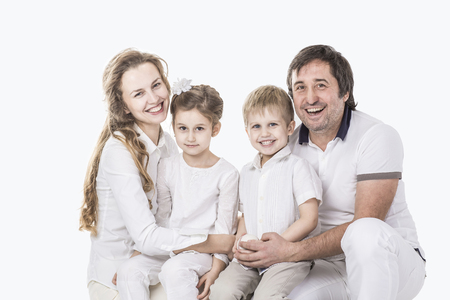 family portrait: parents with daughter and son on white background