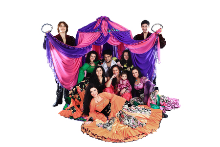 portrait of a Gypsy dance group on the background of the tent