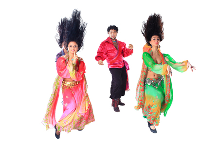 professional dance troupe of Gypsies in traditional dress performs folk dance