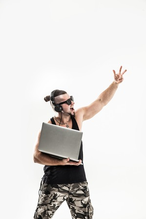 emotional and charismatic DJ - rapper in headphones and with a l Stok Fotoğraf