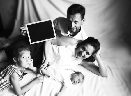 black-and-white photo in retro style happy father, mother and ol Stock Photo