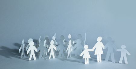 many paper men on the paper background