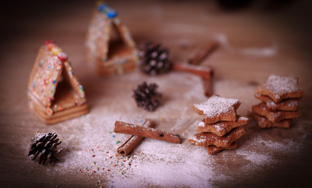 Christmas table. cookies and cinnamon sticks on a blurry backgr Stock Photo