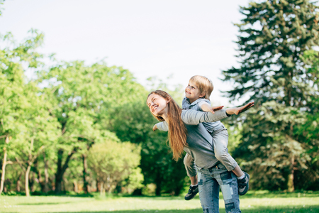 happy mother and son playing in the Park