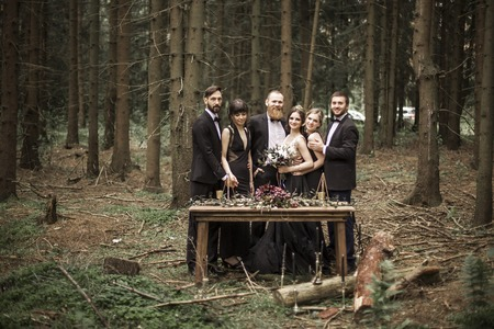 portrait of the couple and witnesses at the picnic in the woods Stock Photo