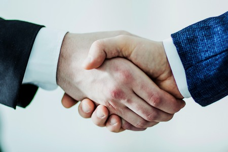 concept of a reliable partnership : a handshake of business partners Stock Photo