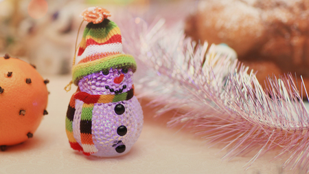 beautiful snowman and festively decorated orange Christmas background