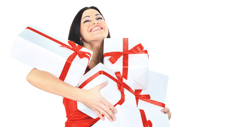 Young happy woman with a gift, closed her eyes  happiness and pleasure