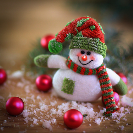 Christmas card. toy snowman on a festive background. Stock Photo