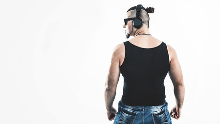 rear view - DJ - rapper with a stylish hairstyle with headphones Stock Photo