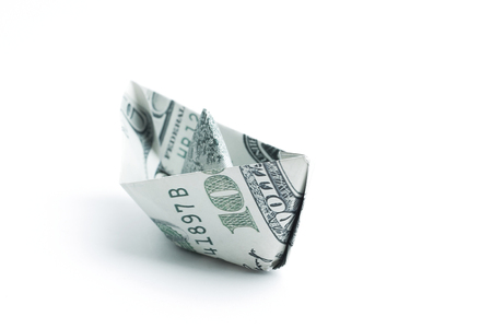 boat made origami from dollar bills.isolated on a white backgro