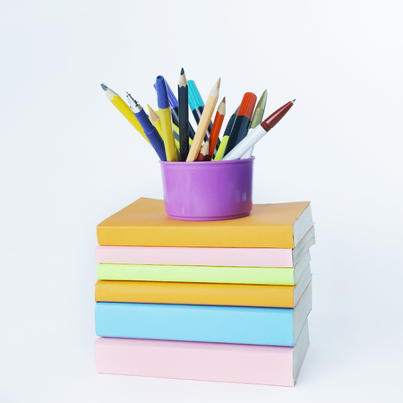 stand with pencils on a stack of books .photo with copy space
