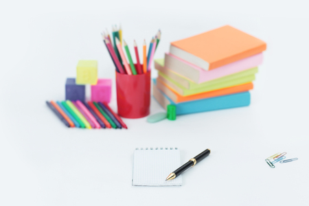 pen and Notepad on blurred background of school supplies .photo with copy space