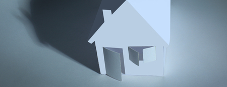 paper house paper background.the concept of a mortgage