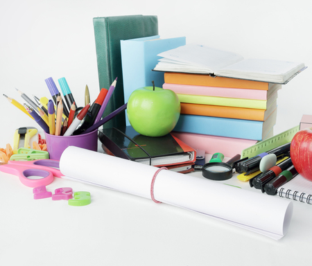 close up.a sheet of drawing paper and school supplies isolated on white background