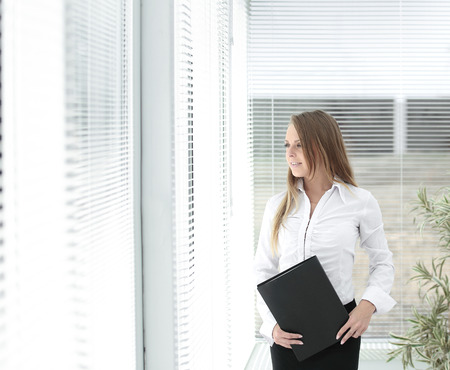 successful business woman with clipbord standing in a modern office Stock Photo