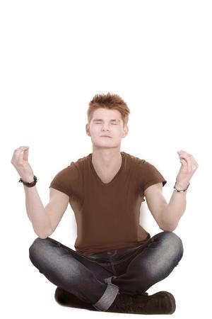 modern guy meditates sitting on the floor