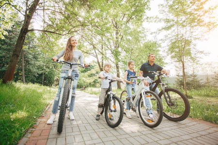 happy family on a bike trip in the Park.