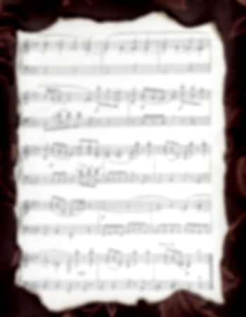 Page of old music book in a blur. background for text