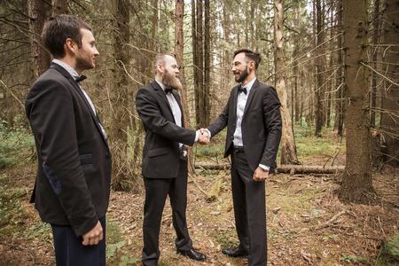 handshake business partners in an informal meeting in nature