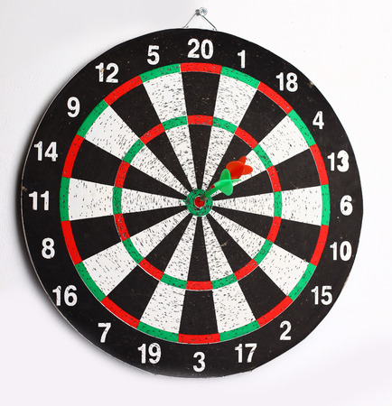 side view.Arrow dart hitting the center of the target dart Board