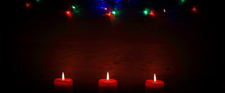 three candles on an abstract festive background