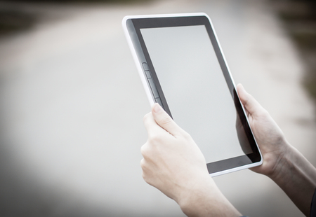 people and technology .closeup of person holding digital tablet