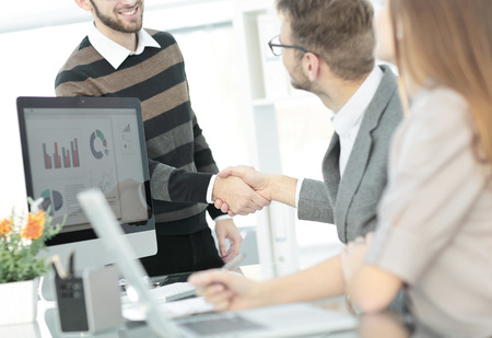 client welcomes the Manager with a handshake