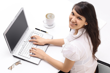 closeup. young employee sitting behind a Desk