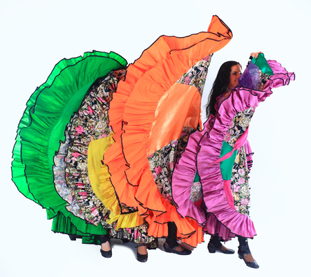professional Gypsy dancing group in national costumes performing folk dance. Stock Photo