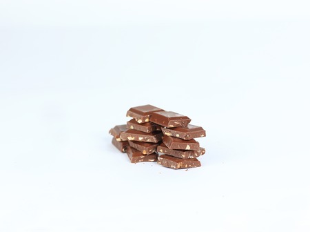 pieces of dark chocolate with nuts isolated on white.photo with copy space