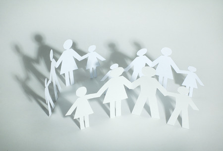 concept of family happiness .group of paper men Stock Photo