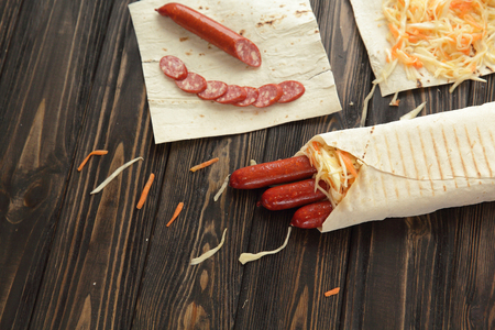 smoked sausages wrapped in pita bread.photo with copy space Standard-Bild