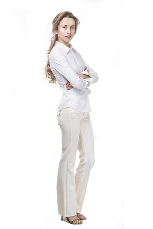 portrait of successful business woman in a stylish white pantsuit over a white background