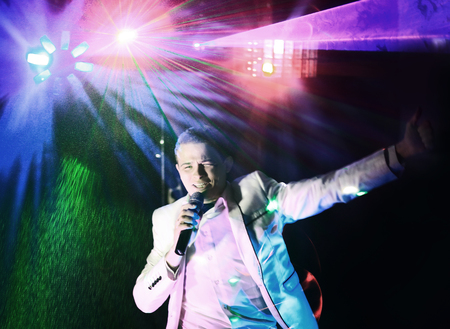 male singer on the stage of the evening show. photo with copy space