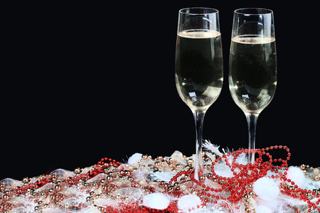 Glasses of champagne decorated, on a black background