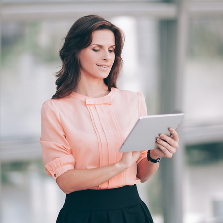 modern business woman typing text on a digital tablet.
