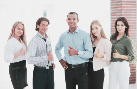 successful multinational business team showing thumb up