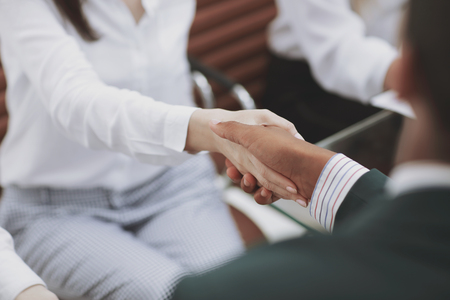 businesswoman shaking hands with partner at office meeting Reklamní fotografie