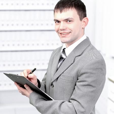 Office worker records work plan for a week Standard-Bild