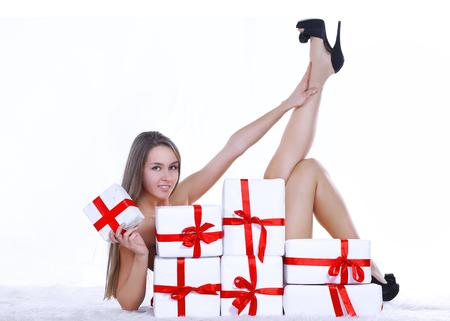 beautiful young woman in Christmas costume lying near the pile Standard-Bild - 107281565