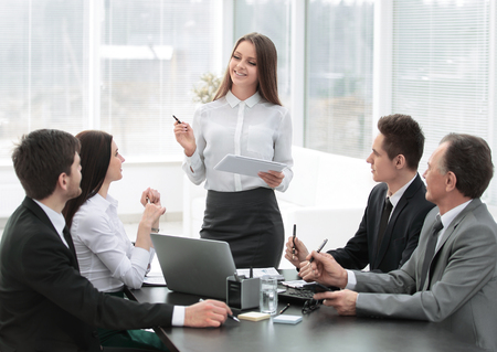 young business woman makes a report on the working meeting Stockfoto