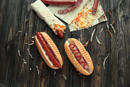 fast food.hot dogs with sauce on wooden background 스톡 콘텐츠