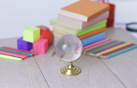 glass globe and school supplies on wooden background.photo with copy space. 版權商用圖片