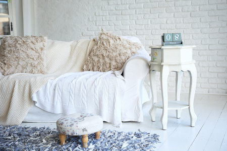white sofa and nightstand with changeover calendar in a stylish living room Stock Photo