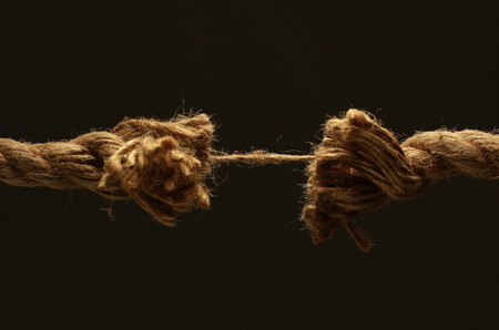 closeup.old frayed rope .isolated on a black background. Stock Photo