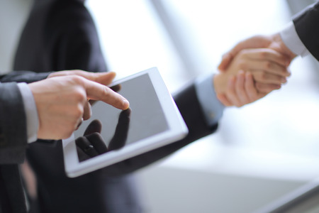 close up.businessman using digital tablet on background of hand