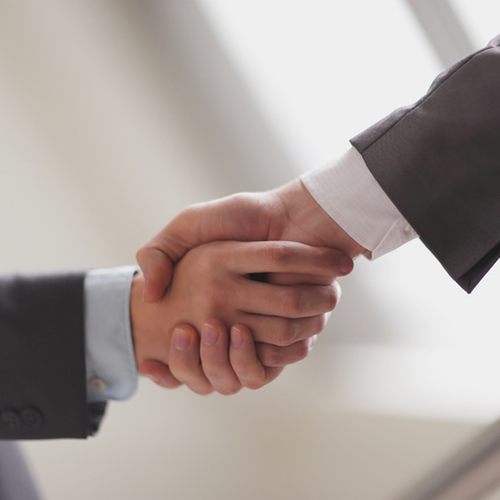 close up.business handshake on blurred office background. Reklamní fotografie