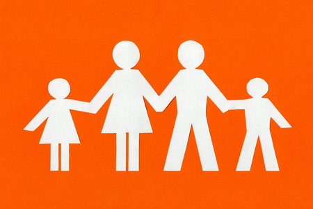 happy paper family on a bright orange background.photo with copy space Stock fotó
