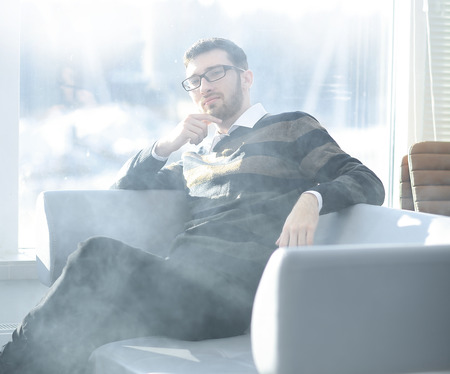 close up.businessman with a cigarette during a coffee break.
